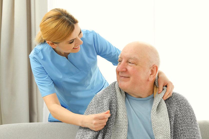 caregiver taking care of senior man