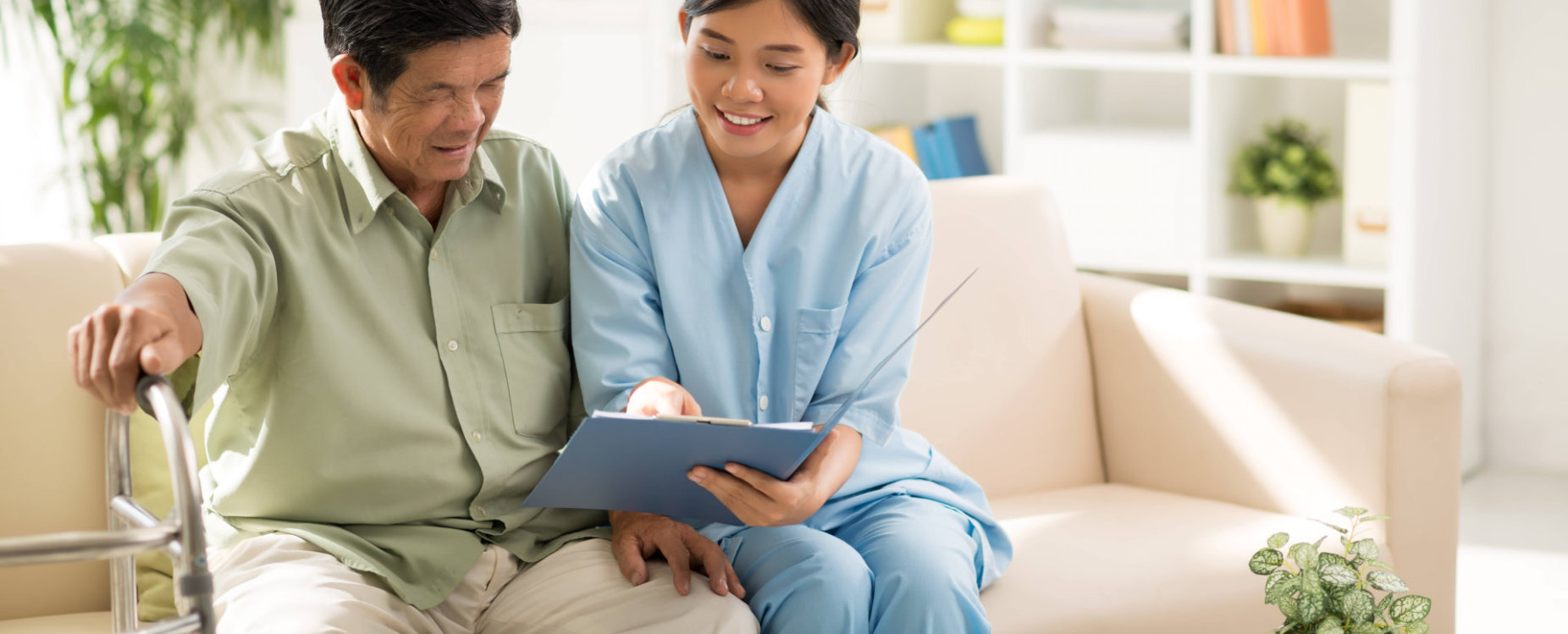 caregiver and senior man reading medical results