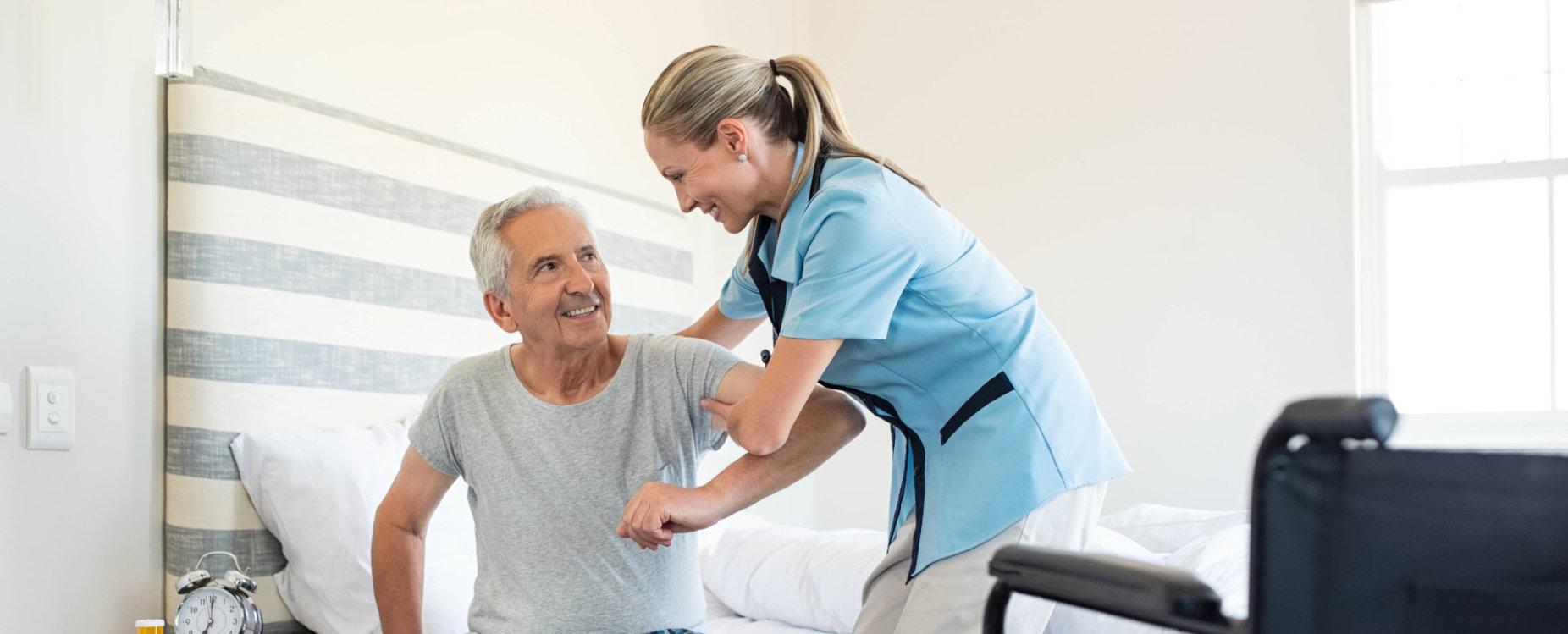 caregiver assisting adult man