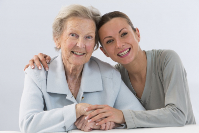 caregiver and senior woman are happy